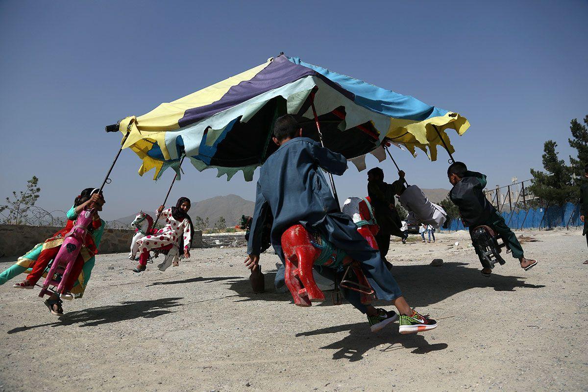 Children ride on swings in Kabul Afghanistan.jpg