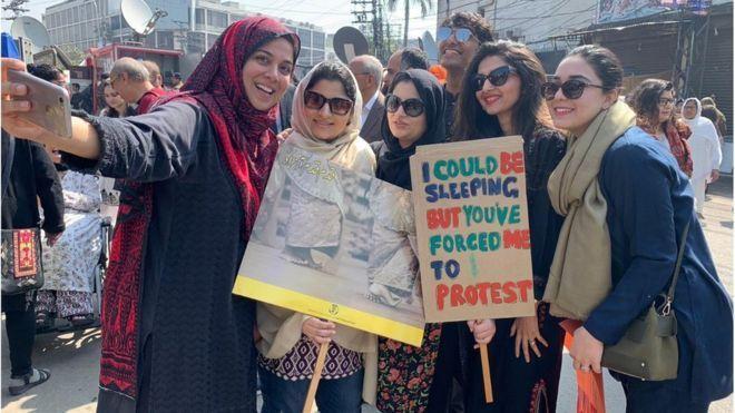 lahore women march placard.jpg